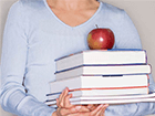 balanced-scorecard-woman-books-apple-crop-140x105