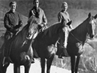 photo of three horses and riders