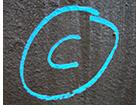 copyright-symbol-blue-chalk-on-blackboard