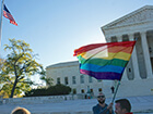 US-Supreme-Court-with-rainbow-flag-and-US-flag