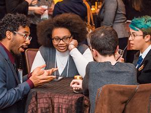 Symposium participants in conversation