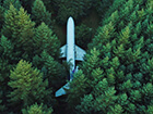 aerial view of an airplane in the woods