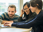uiuc-media-commons-three-people-around-laptop