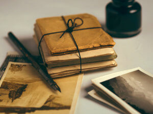 bundle of old photos wrapped in paper