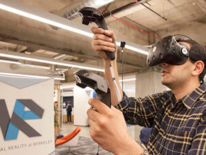man wearing virtual reality headset and using motion controllers