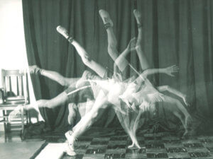 slow shutter-speed photo of person doing cartwheel