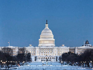 US Capitol in snow at dusk