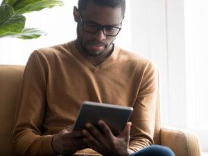 Man focused on tablet computer