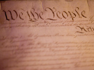 "closeup photo of ""We the People"" part of US Constitution"