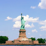 photo of Statue of Liberty and crowd of people on Ellis Island