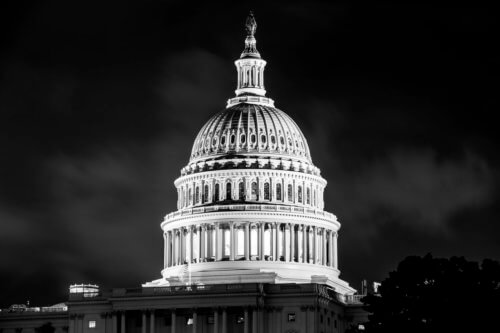 black-and-white photo of US Capitol at night