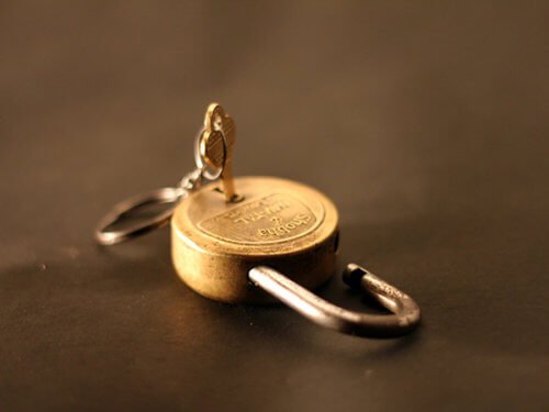 photo of an open padlock with key in it