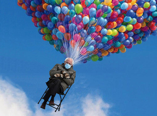 photo of Bernie Sanders wearing mittens seated in chair being lifted up into blue sky by huge multicolored bunch of balloons