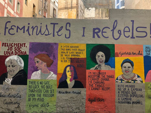 Mural with images and quotes from five women: Maria Aurèlia Capmany, Virginia Woolf, Maria Mercè Marçal, Angela Davis, and Rigoberta Menchú