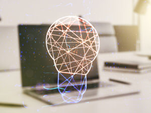 hologram of networked lightbulb with laptop computer in background