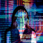 photo of a woman with software code projected in multicolor