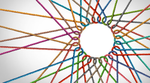 photo of interwoven, multicolored ropes radiating out from an open circle